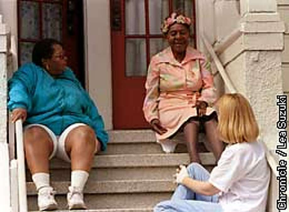 FROM LEFT: Gene Washington, Rosalie Britton and Shelly Meagher. Britton, who has lived in the same house on Page Street since February of 1952, talks with her neighbor Shelley Meagher and ex-resident, Gene Washington. Photo By Lea Suzuki