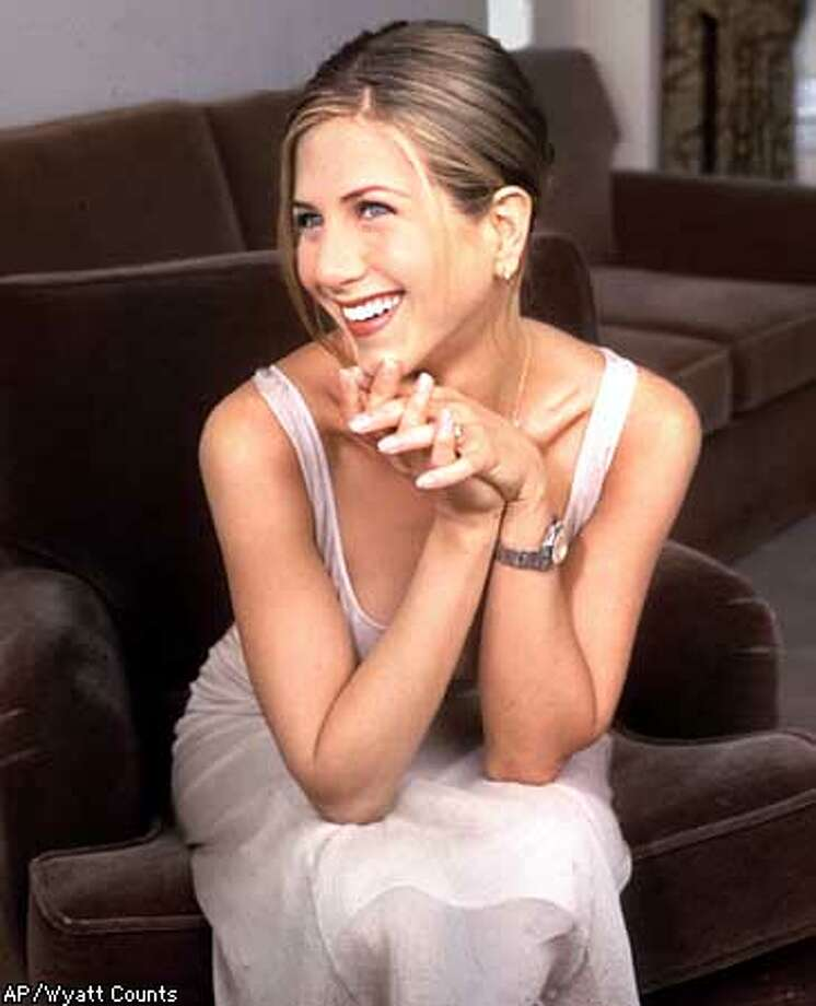 """Actress Jennifer Aniston poses in New York July 20, 1997. Aniston stars in the new movie, """"Picture Perfect."""" (AP Photo/Wyatt Counts)"""