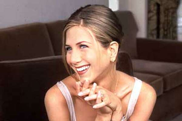 "Actress Jennifer Aniston poses in New York July 20, 1997. Aniston stars in the new movie, ""Picture Perfect."" (AP Photo/Wyatt Counts)"
