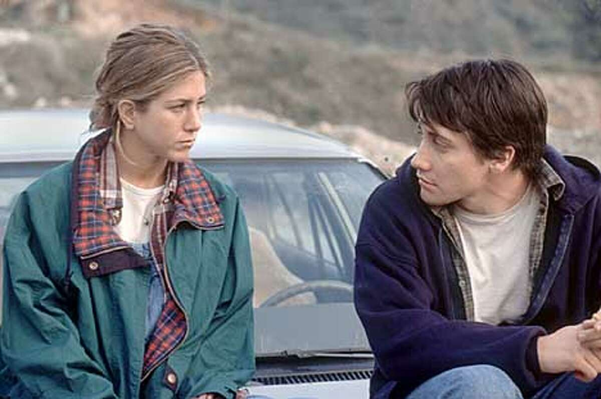 Actress Jennifer Aniston (L) and Jake Gyllenhaal are pictured in a scene from their new drama film