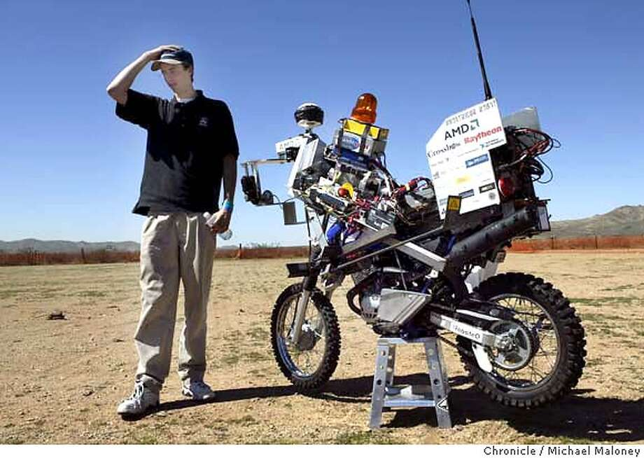 Anthony Levandowski, 23 of Albany, CA will be happy if his motorcycle makes it only 30 yards in Saturday's competition. His modified 125cc bike called the Ghost Rider Robot still has some bugs in the computer programming.  On Saturday, 15 teams will compete in a cross desert race from Barstow, CA to Primm, Nv near Las Vegas for a $1 million 1st place prize. The race involves modified unmanned robotic controlled vehicles and is sponsored by the Pentagon which is hoping to accelerate robotic technology for future military use. On Friday , the teams were doing last minute tinkering on their high tech robotic vehicles near the start line in Barstow.  Photo by Michael Maloney / The Chronicle Photo: Michael Maloney