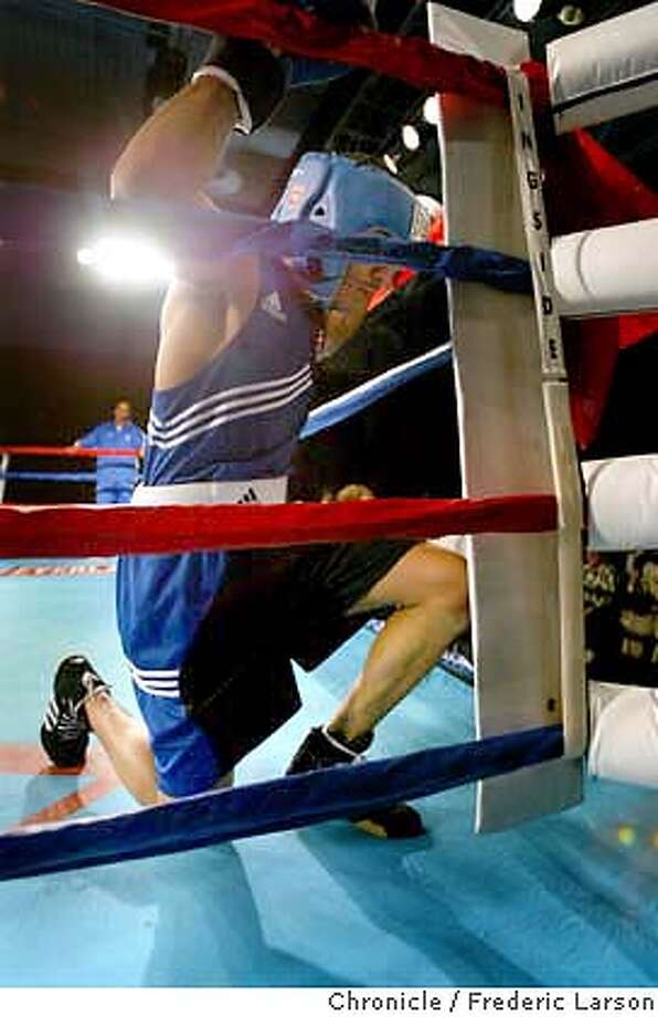 ; Andre Ward knees down to pray before his match with Andre John Dovi of France during a Olympic-style boxing duel between team USA and team France in Reno Saturday night November 1, 2003. FREDERIC LARSON / The Chronicle Photo: FREDERIC LARSON