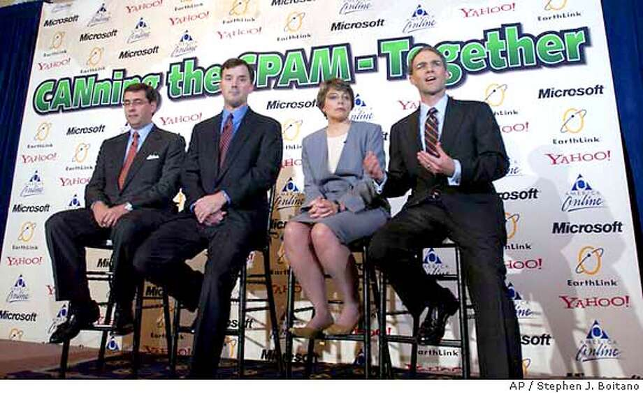 "AOL Executive Vice President and General Counsel Randy Boe, left, Earthlink Vice President and Assistant General Counsel Les Seagraves, second left, Microsoft Deputy General Counsel Nancy Anderson, second right, and Yahoo! Senior Vice President and General Counsel Mike Callahan, right, announce the filing of six lawsuits against hundreds of people they say sent millions of unwanted e-mails in violation of a new U.S. law against ""spam"" during a news conference Wednesday, March 10, 2004 in Washington. It is the first major industry action under the ""can spam"" legislation that went into effect January 1, 2004. (AP Photo/Stephen J. Boitano) Photo: STEPHEN J. BOITANO"