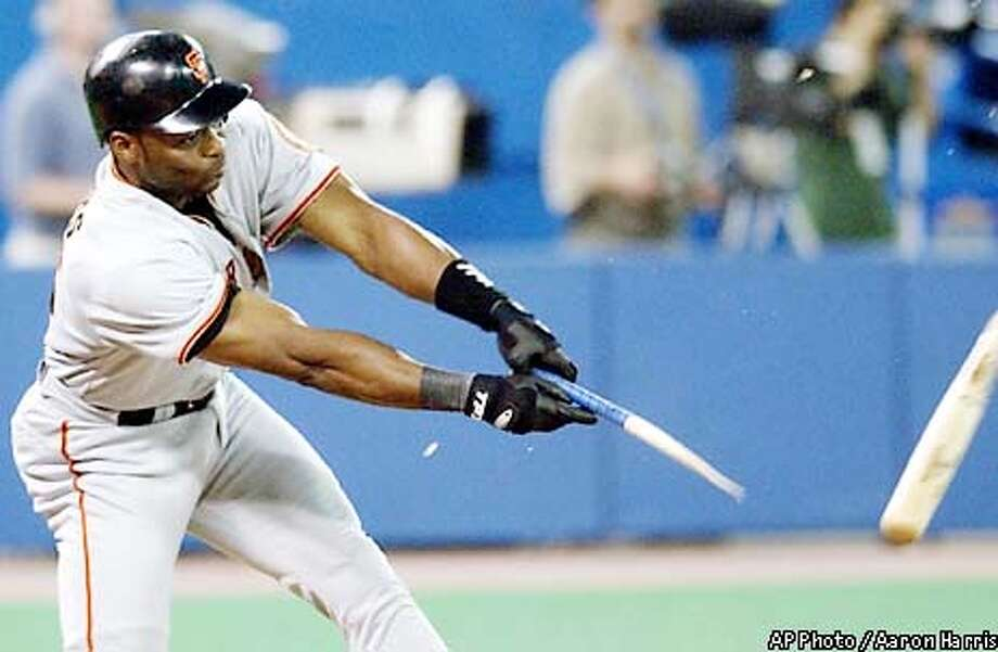 San Francisco Giants' Reggie Sanders doubles on a broken bat during the fourth inning of play against the Toronto Blue Jays in Toronto Tuesday, June 11, 2002. Giants' J.T. Snow and Tsuyoshi Shinjo scored on the hit. (AP Photo/Aaron Harris) Photo: AARON HARRIS