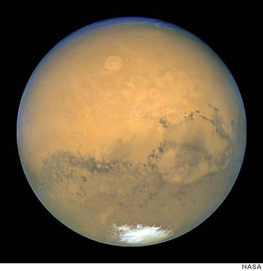 Mars is shown within minutes of the planet's closest approach to Earth in nearly 60,000 years in this image taken by NASA's Hubble Space Telescope. This image was made from a series of exposures taken between 5:35 a.m. and 6:20 a.m. EDT Aug. 27 with Hubble's Wide Field and Planetary Camera 2. In this picture, the red planet is 34,647,420 miles (55,757,930 km) from Earth. (AP Photo/NASA, HO) The Hubble Space Telescope is shown following its release from the space shuttle Discovery in this Feb. 19, 1997, file photo.