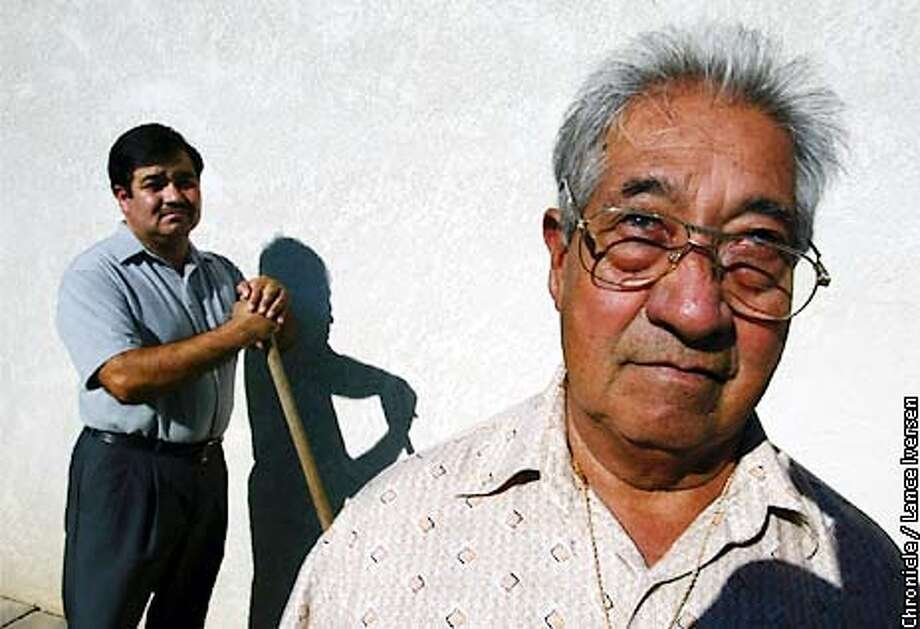 WORKERSA-C-11JUN02-MT-LI  Lucinao Magana age 80 (right) worked in northern Calif since 1943 in the Bracero Program, retiring at the age of 75. his son Luis Magana has been lobbing on behalf of the bracero's to restore funds taken from their checks for retirement but never dispersed. BY LANCE IVERSEN/SAN FRANCISCO CHRONICLE Photo: LANCE IVERSEN