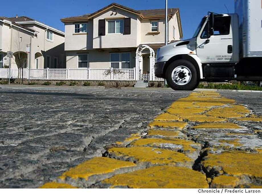 ; The road at Center Avenue, between Glacier and Redwood, suffered a lot of cracks and spider webbing as a result of big rigs carrying heavy loads to build a new housing complex at the corner. City:� 3/11/04, in Martinez, CA. Frederic Larson/The Chronicle; Photo: Frederic Larson