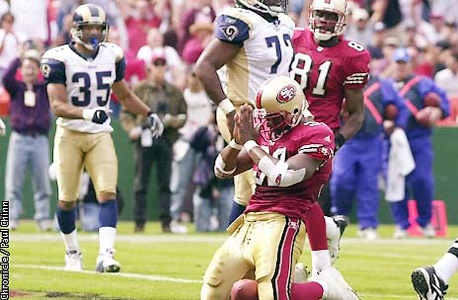 49ers Kevan Barlow appears to say a prayer after getting in to the end zone in the second quarter as the San Francisco 49ers played the St. Louis Rams at 3Com Ballpark in San Francisco, Ca., on Sunday, September 23, 2001. (PAUL CHINN/SAN FRANCISCO CHRONICLE) Photo: PAUL CHINN