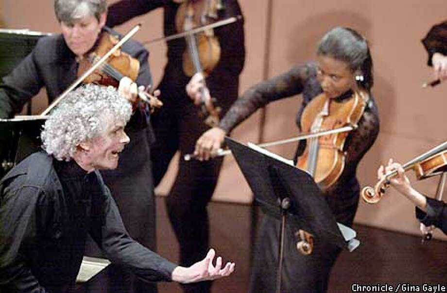 Visiting conductor Sir Simon Rattle led the normally conductorless New Century Chamber Orchestra at Herbst Theatre. Chronicle photo by Gina Gayle