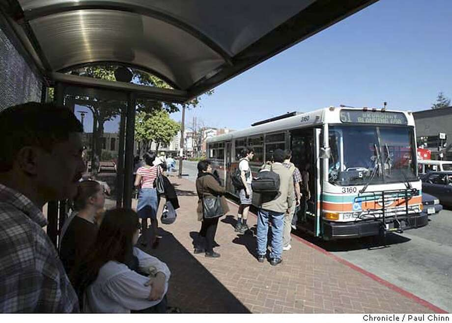 Passengers get ready to board AC Transit buses at Shattuck Ave. and Allston Way on 3/10/04 in downtown Berkeley. It will soon be against the law to smoke anywhere near a bus stop in Berkeley. PAUL CHINN/The Chronicle Photo: PAUL CHINN