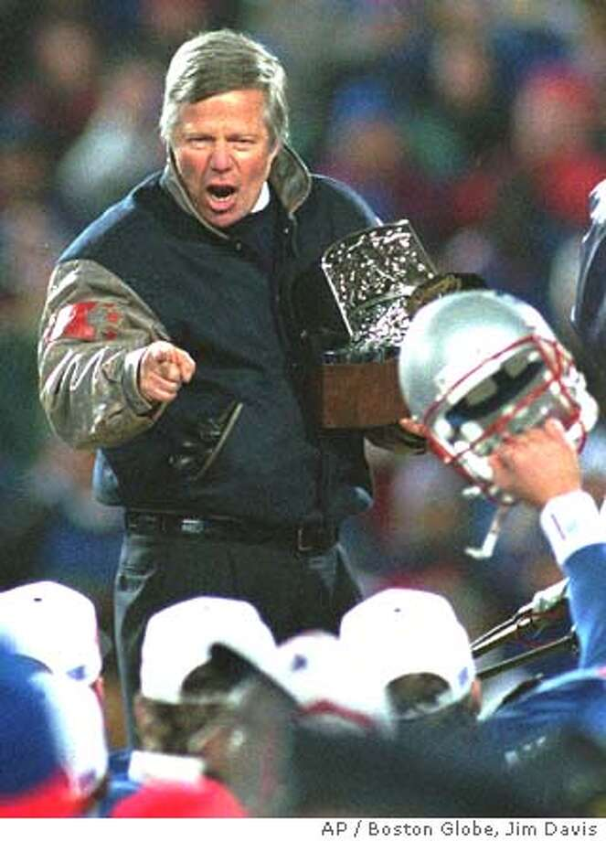 New England Patriots owner Robert Kraft points to his players as he holds the AFC Championship trophy in Foxboro, Mass., Sunday, Jan. 12, 1997, after the Patriots defeated the Jacksonville Jaguars, 20-6. (AP Photo/Boston Globe, Jim Davis) Photo: JIM DAVIS