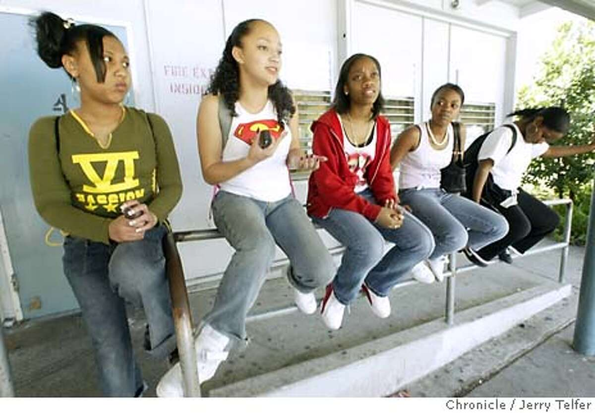 athletics10_073_jlt.jpg Sophomores Deanna Donaldson, Elisa Rojas, Marin Stephens, Vanessa Smith, and Andrenika Nabors perch on a rail after taking part in the student walkout at De Anza High School. All are participants in intramural sports. Along with many other students in the district, they are upset about program cuts in West Contra Costa County Unified School District budgets, which include all intramural sports activities and library services for the high schools, and elementary music programs. Event on 3/9/04 in El Cerrito. Jerry Telfer / The Chronicle