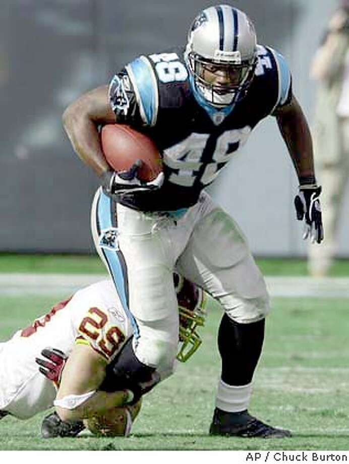 Carolina Panthers' Stephen Davis (48) is dragged down by Wshington Redskins' Todd Franz (29)after a short gain in the second quarter in Charlotte, N.C., Sunday Nov. 16, 2003. (AP Photo/Chuck Burton) Photo: CHUCK BURTON