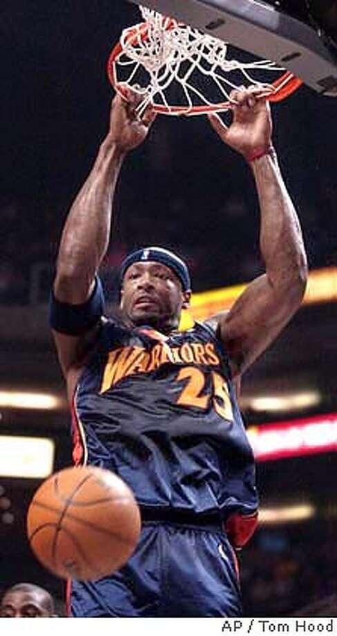 Golden State Warriors center Erick Dampier slam dunks in the first quarter against the Phoenix Suns Friday, Jan. 16, 2004, in Phoenix. (AP Photo/Tom Hood) Photo: TOM HOOD