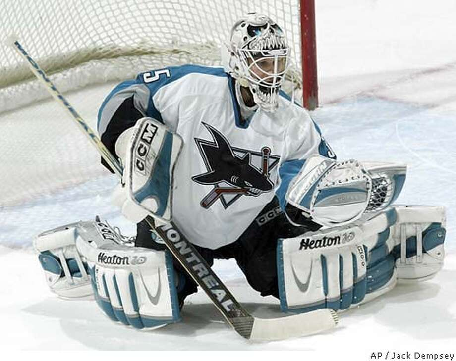 Sharks goaltender Vesa Toskala, filling in for new father Evgeni Nabokov, makes a save in the first period against Colorado. Associated Press photo by Jack Dempsey