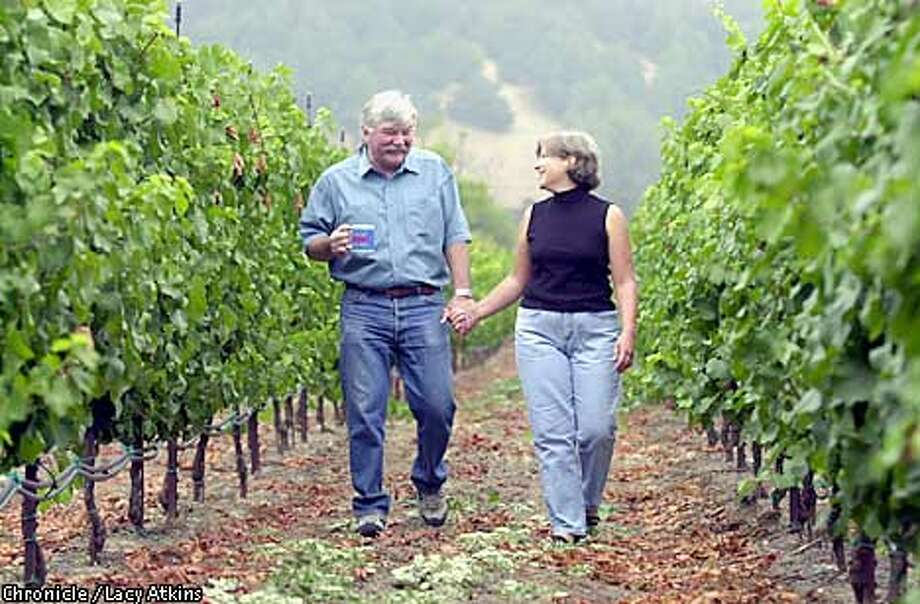 Lover's Lane: At home in Santa Rosa, winemakers Julia and Bob Iantosca stroll through their private 6-acre Pinot Noir vineyard. Chronicle photo by Lacy Atkins