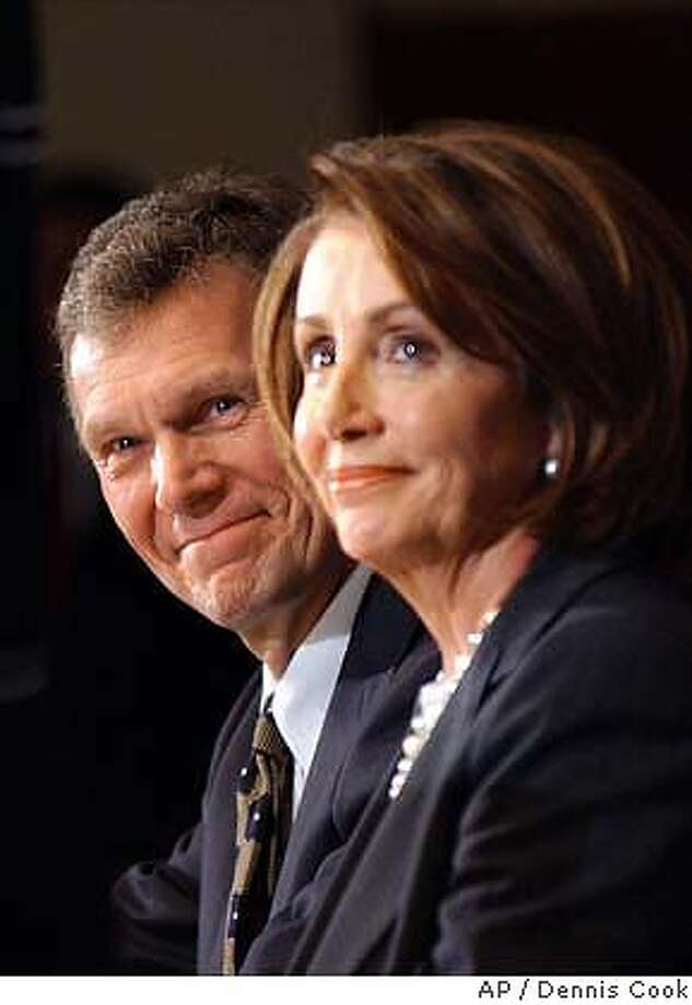 Senate Democratic leader Tom Daschle, D-S.D., and House Minority Leader Nancy Pelosi, D-Calif., appear at a National Press Club news conference in Washington Friday, Jan. 16, 2004, to discuss Democratic priorities. (AP Photo/Dennis Cook) Photo: DENNIS COOK