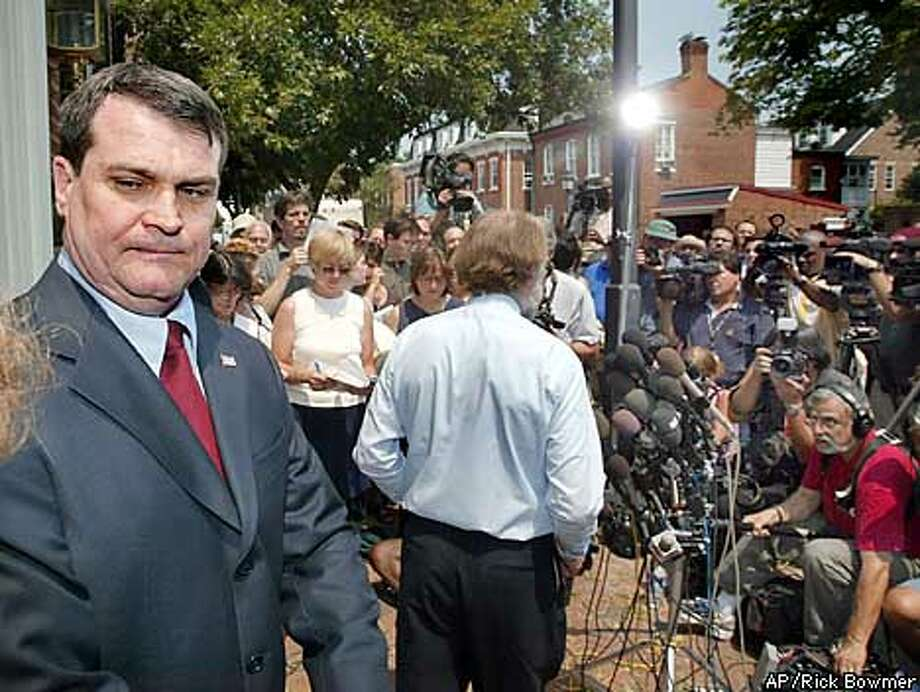 Dr. Steven J. Hatfill, left, a bioweapons expert under scrutiny for the anthrax attacks, listens as his lawyer Victor M. Glasberg, center, speaks during a news conference outside Glasberg's office Sunday, Aug. 11, 2002, in Alexandria, Va. Hatfill is defending himself Sunday, complaining that leaks from the FBI are destroying his life while law enforcement officials have said Hatfill is one of about 30 scientists being looked at in the anthrax investigation. (AP Photo/Rick Bowmer) Photo: RICK BOWMER