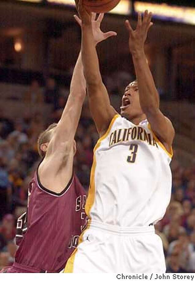 newell_520_jrs.jpg  Cal men's basketball vs. Saint Joseph's in the Pete Newell Challenge at the Arena in Oakland. Dominic McGuire of Cal drives against Pat Carroll of St. Joseph's.  12/20/03 in Oakland. John Storey / The Chronicle MANDATORY CREDIT FOR PHOTOG AND SF CHRONICLE/ -MAGS OUT Photo: John Storey