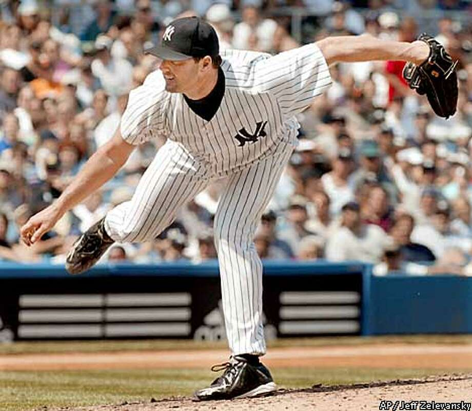 New York Yankees pitcher Roger Clemens pitched around Barry Bonds all day -- except when he hit Barry on the wrist with a pitch in the third inning. Associated Press photo by Jeff Zelevansky