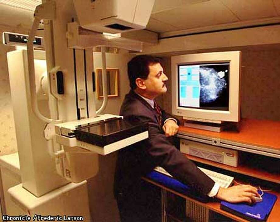 X-RAY/C/21AUG97/BU/FRL: Aiman Abdel-Malek, Ph.D Manager and Networked Systems, GE Research and Development, demonsates new telemammography that uses a satellite link for transmitting mammograms. GE Medical systems along with EG&G, Inc. manufacture a first-of-its-kind multi-purpose x-ray dector that has the potential for better, faster, and more cost-effective-x-ray examinations for patients. Chronicle photo by Frederic Larson.