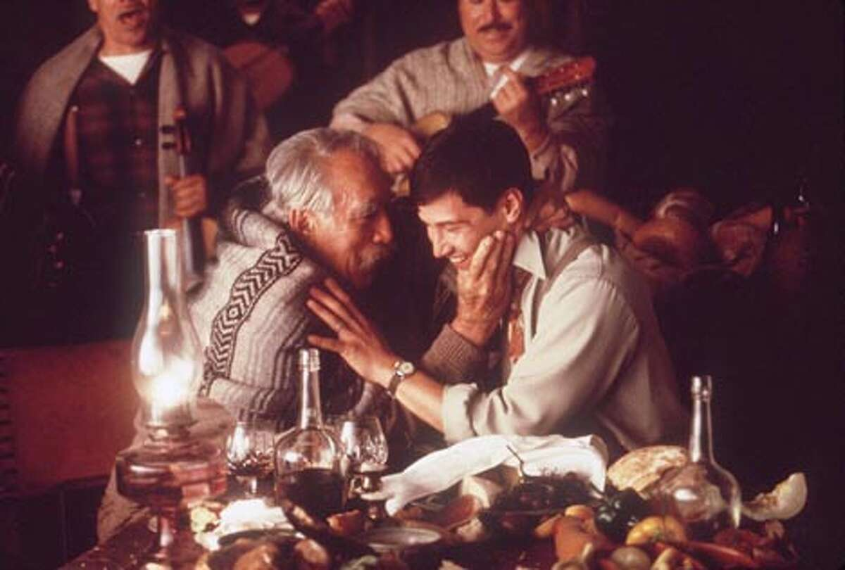 Anthony Quinn and Keanu Reeves share a drink and a song in scene from `A Walk in the Clouds' CAT