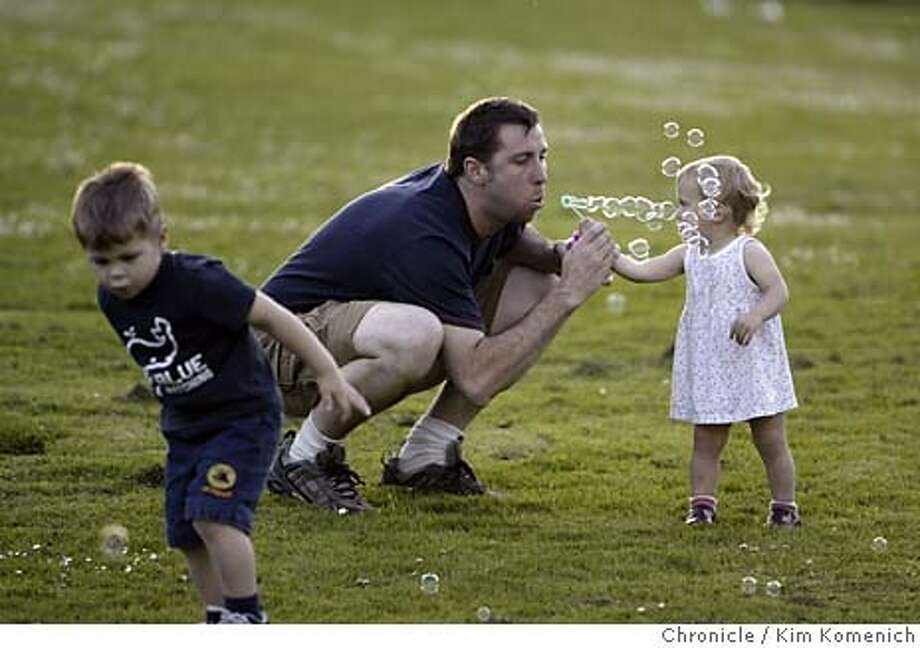 Drew McAdams of San Francisco and his son Dylan (2 yrs, 10 mos.) and daughter Angelina, 1 1/2, play with bubbles on the lawn at the Conservatory of Flowers. Chronicle photo by Kim Komenich in San Francisco Photo: Kim Komenich