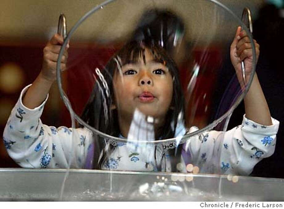 The phenomenon of interactivity in museums where children interact with the exhibits at the San Francisco Exploratorium. Low-tech kinds of things-- like Lauren DeVera (4) of Daly City the enjoying the soap bubbles exhibit which keeps the young children smiling. Photo: FREDERIC LARSON