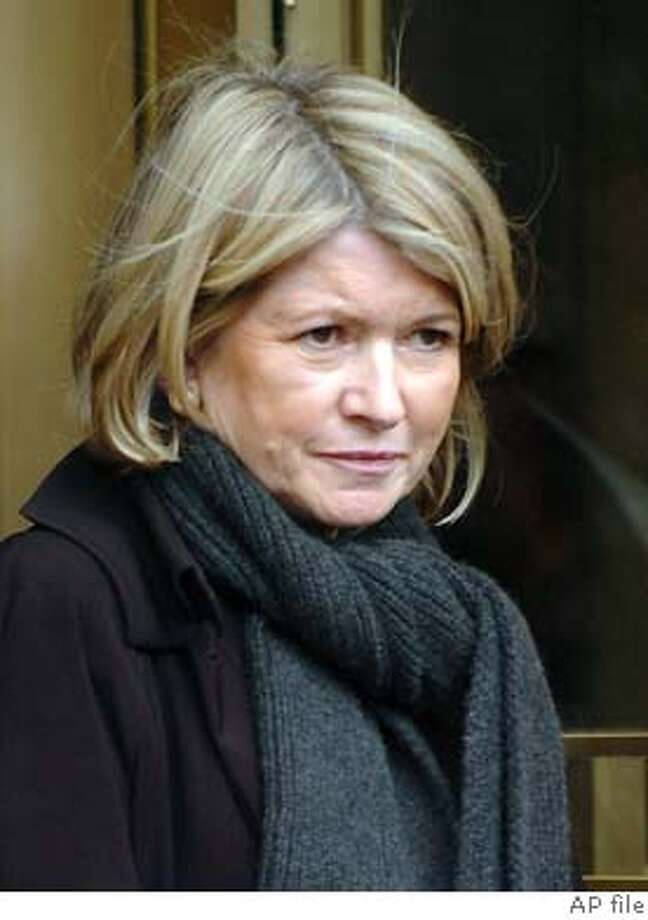 Martha Stewart exits Manhattan federal court after meeting with a probation officer following her Friday conviction, Monday, March 8, 2004, in New York. (AP Photo/ Louis Lanzano) Stewart Photo: LOUIS LANZANO