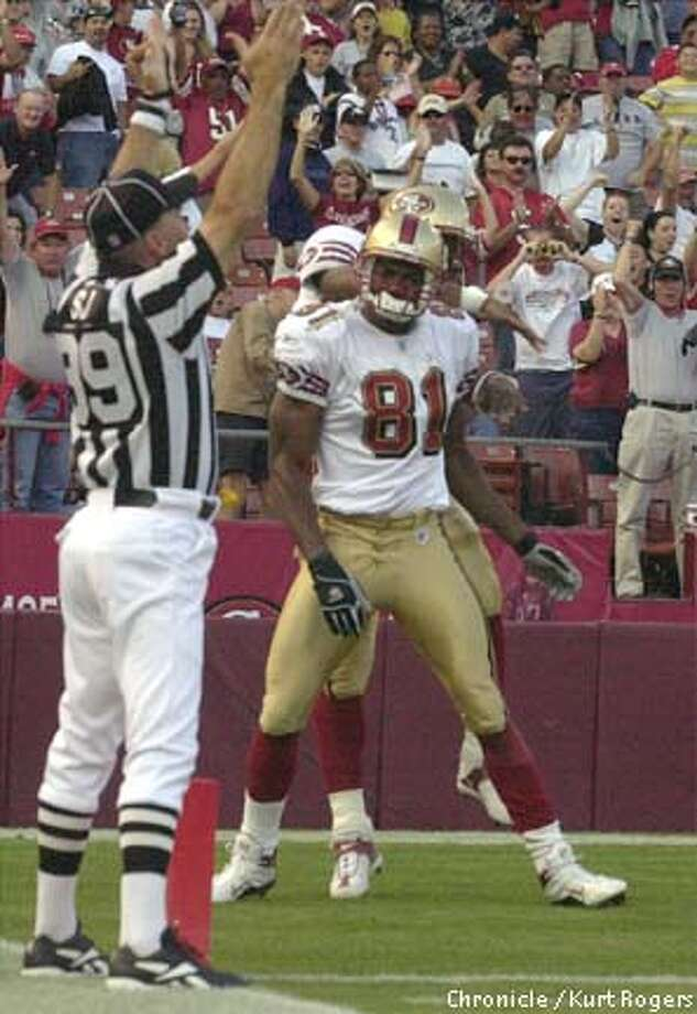 Terrell Owens looks at the side judge signal touchdown after the receiver's bold 71-yard catch-and-run. Chronicle photo by Kurt Rogers