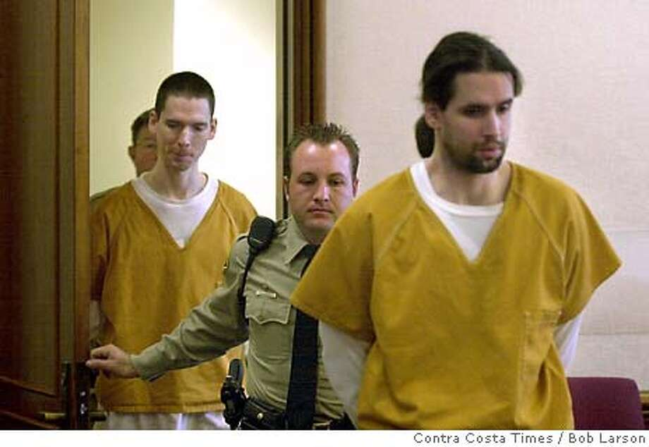 Brothers Justin Helzer, 29, left, and Glenn Helzer, 31, are led into court for a preliminary hearing in Martinez, Cailf., Monday Dec. 3, 2001. The Helzers and their housemate Dawn Godman, 27, are accused of going on a killing spree that left five people dead including Selina Bishop, the daughter of blues guitarist Elvin Bishop. (AP Photo/Contra Costa Times / Bob Larson ) Photo: BOB LARSON