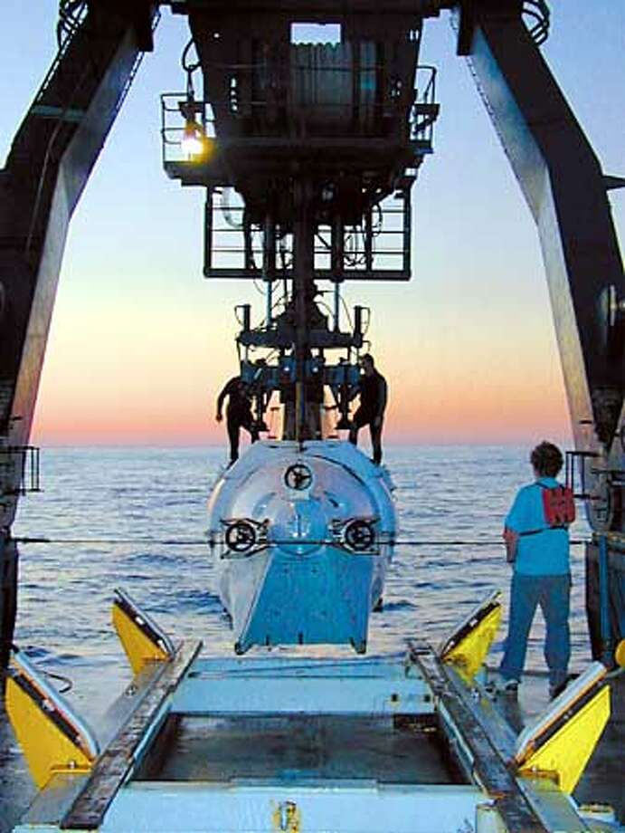 Scientists from the University of Delaware and Amersham Biosciences have conducted the first-ever DNA sequencing experiments to be carried out while at sea. Using the research vessel Atlantis and submersible Alvin, the team is carrying out a pioneering environmental genomic study of the life that inhabits hydrothermal vents two miles deep in the Pacific Ocean. The scientists estimate that they will sequence two million base pairs of DNA at the end of the 17-day cruise. Photo: Handout