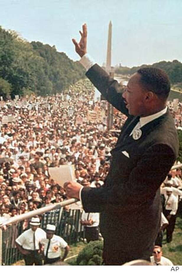 "** ADVANCE FOR SUNDAY, AUG. 24 **FILE** The Rev. Martin Luther King Jr. acknowledges the crowd in front of the Lincoln Memorial for his ""I Have a Dream"" speech in Washington, D.C., on Aug. 28, 1963. (AP Photo)"