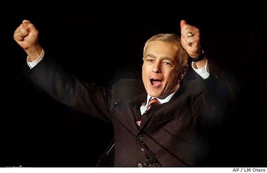 Presidential hopeful Wesley Clark raises his arms during a speech at a fund raising dinner in Dallas, Monday, Jan 12, 2004. (AP Photo/LM Otero) Photo: LM OTERO
