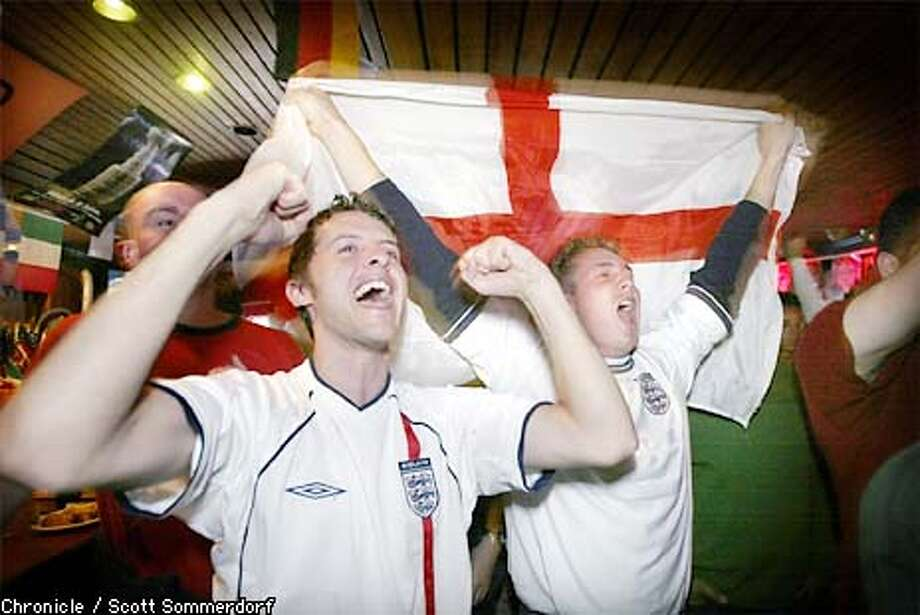 Danny Mears (right;CQ) - with English flag - exults with his friends after the 1-0 win over Argentina is official. He and over 100 other soccer fans packed the Kezar Pub on Stanyan Street in the Haight to watch the england/Argentina world cup match. (SF CHRONICLE PHOTO BY SCOTT SOMMERDORF) Photo: SCOTT SOMMERDORF