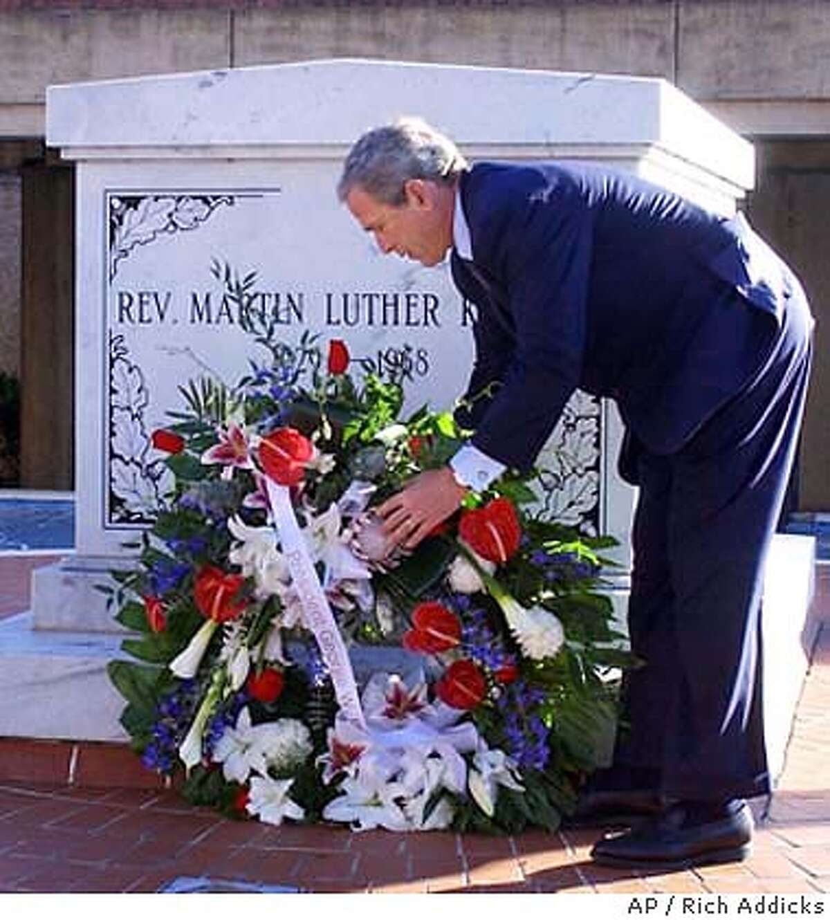 President Bush lays a wreath at the tomb of Martin Luther King Jr., Thursday, Jan. 15, 2004, at the King Center in Atlanta. Bush was in Atlanta to honor King as well as attend a fund-raiser at the Georgia World Congress Center. (AP Photo/The Atlanta Journal-Constitution, Rich Addicks) President Bush lays a wreath at Martin Luther King Jr.'s grave. President Bush lays a wreath at Martin Luther King Jr.'s grave.