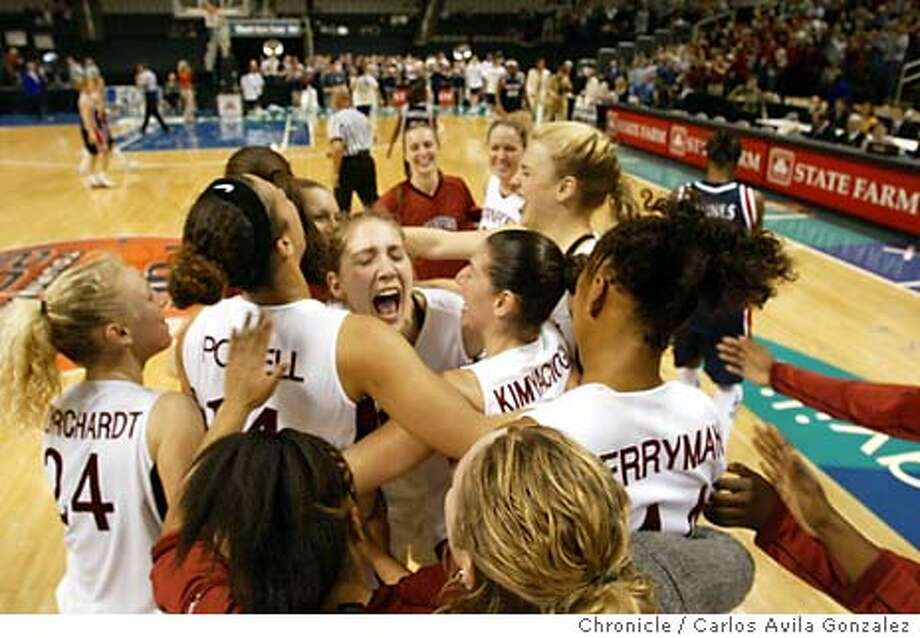 Stanford Cardinal women's basketball team mob each other on the court following their Pac-10 championship win against the University of Arizona Wildcats. Stanford University Women's basketball versus University of Arizona at HP Pavilion in San Jose, Ca., on Monday, March 8, 2004. .  Event on 3/8/04 in San Jose, CA. Carlos Avila Gonzalez / The San Francisco Chronicle Photo: Carlos Avila Gonzalez