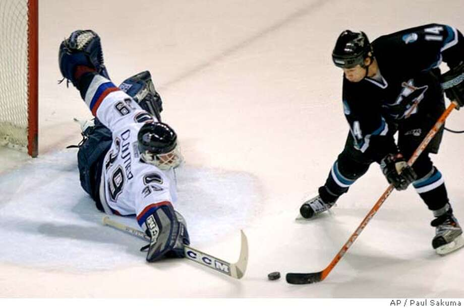 San Jose Sharks right wing Jonathan Cheechoo is unable to score past Vancouver Canucks goalie Dan Cloutier in the first period, Thursday, Jan. 15, 2004, in San Jose, Calif. (AP Photo/Paul Sakuma) Photo: PAUL SAKUMA