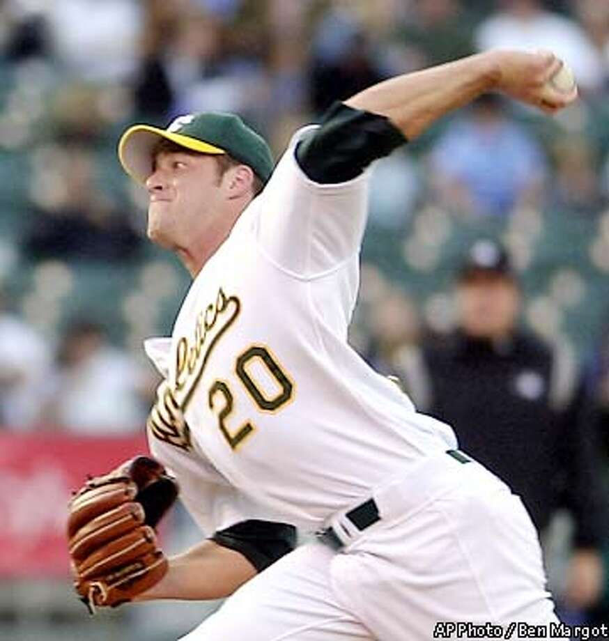 Oakland Athletics' Mark Mulder winds up against the Houston Astros in the first inning Friday, June 7, 2002, in Oakland, Calif. (AP Photo/Ben Margot) Photo: BEN MARGOT