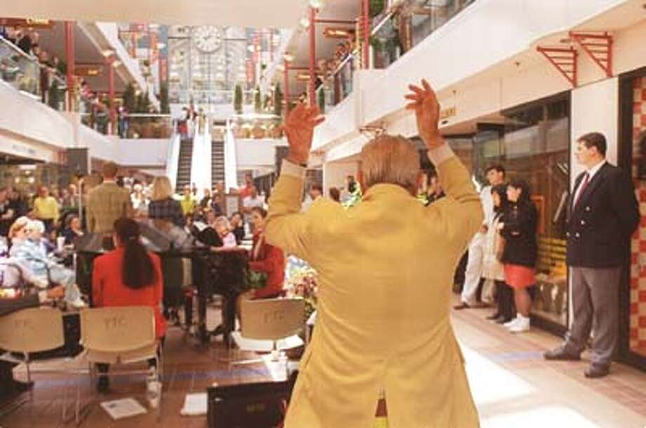 Dominic Fiorella, 74, dances at the Crocker Galleria while the Lunch Bag Opera performs inside.  Photo By Lea Suzuki Photo: LEA SUZUKI