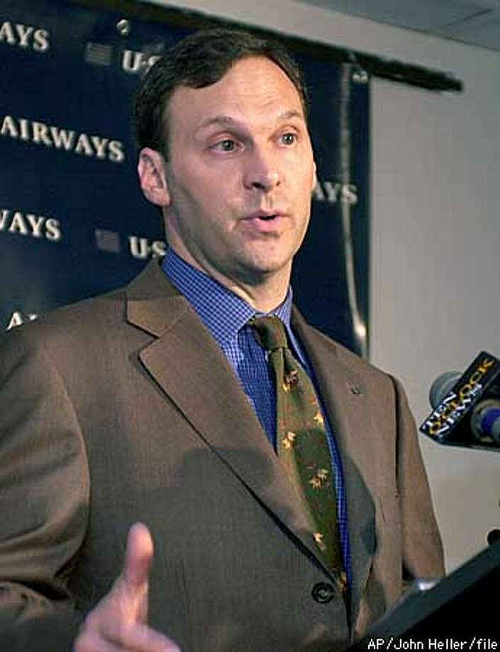 "** FILE ** David Siegel, president and CEO of US Airways, talks with reporters in this May 29, 2002 file photo, at Greater Pittsburgh International Airport. US Airways, hard hit by the drop in travel after the Sept. 11 terrorist attacks, filed for Chapter 11 bankruptcy protection Sunday, August 11, 2002 the company said. Siegel said, ""US Airways will continue to operate while we complete our financial restructuring, and our customers should be confident that we will continue service to the more than 200 communities in our network."" (AP Photo/John Heller, File) Photo: JOHN HELLER"