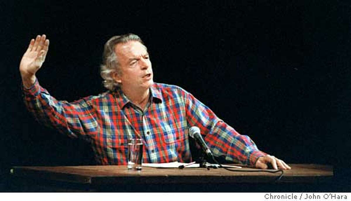 """GRAY#3/C/29DEC97/DD/JO'H Spalding Gray in """"It's a Slippery Slope"""". playing at the Geary Theater. Photo by.........john O'Hara Spalding Gray, here in Its a Slippery Slope at the Geary Theater, performed in workaday plaid shirts behind a plain desk. Spalding Gray, here in Its a Slippery Slope at the Geary Theater, performed in workaday plaid shirts behind a plain desk."""