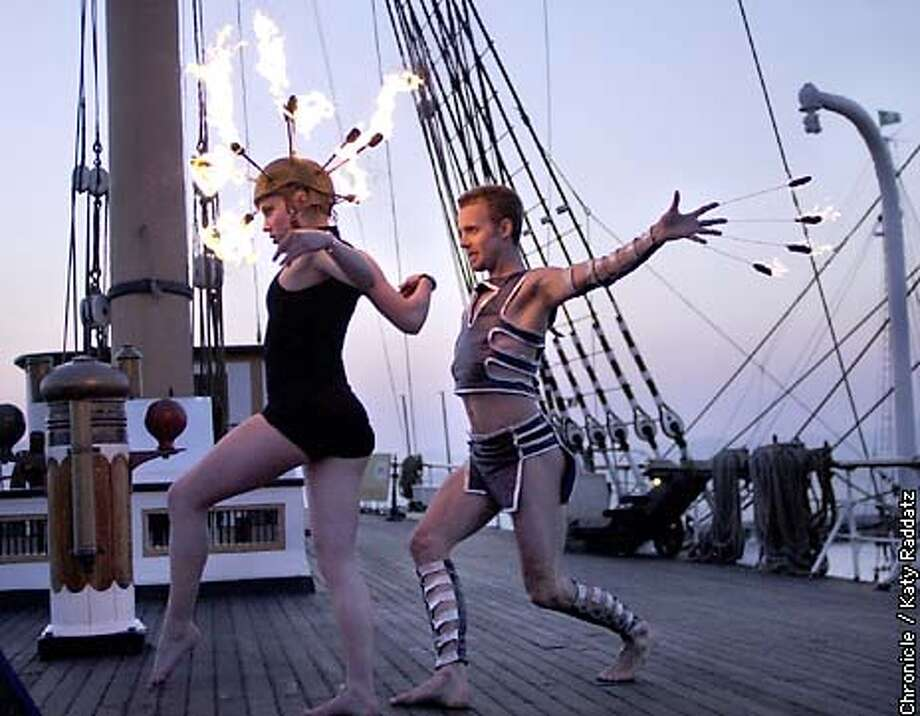 PHOTO BY KATY RADDATZ--THE CHRONICLE  Story by reporter Anastasia Hendrix about Mike Shaw's footage being shot for commercial to promote arts in SF. We go to the Hyde St. Pier to see: firedancers are Jamie Duggan and Alexander Zendzian.