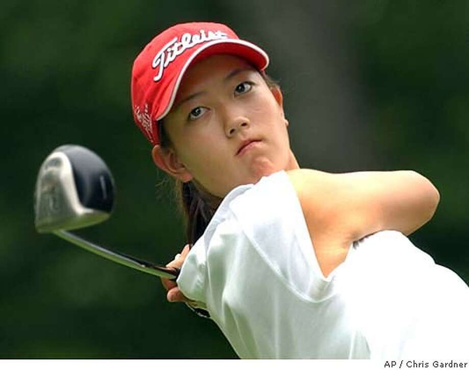 Michelle Wie of Honolulu watches her drive on the fifth hole during her match play round against Maru Martinez at the U.S. Women's Amateur Championship at the Philadelphia Country Club in Gladwyne, Pa., Thursday, Aug. 7, 2003. Martinez won the match one up. (AP Photo/Chris Gardner) When she tees off today, 14-year-old Michelle Wie will be the youngest player ever to play a PGA Tour event. When she tees off today, 14-year-old Michelle Wie will be the youngest player ever to play in a PGA Tour event. Photo: CHIRS GARDNER