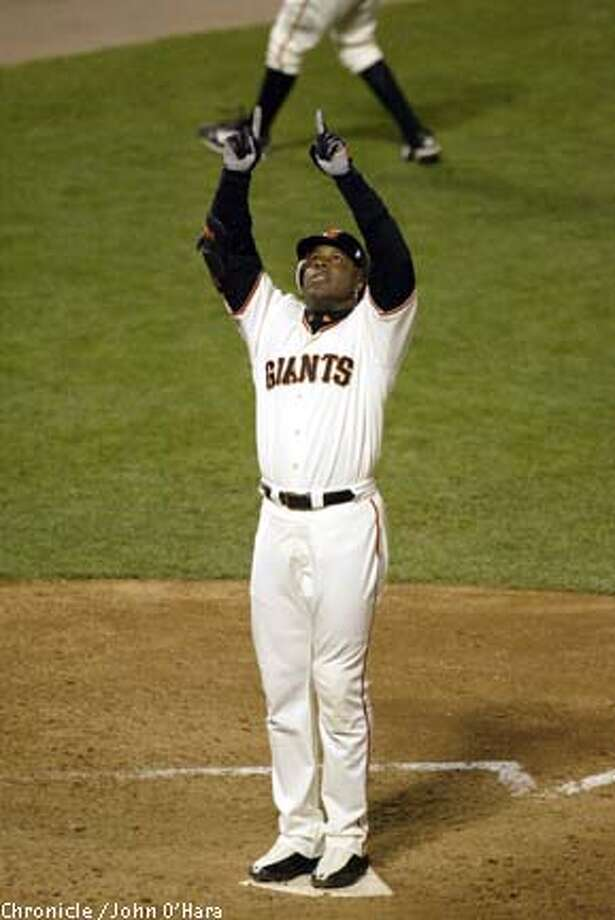 Barry Bonds says he will have a hard time passing the next man on the homer list -- his godfather, Willie Mays. Chronicle photo by John O'Hara