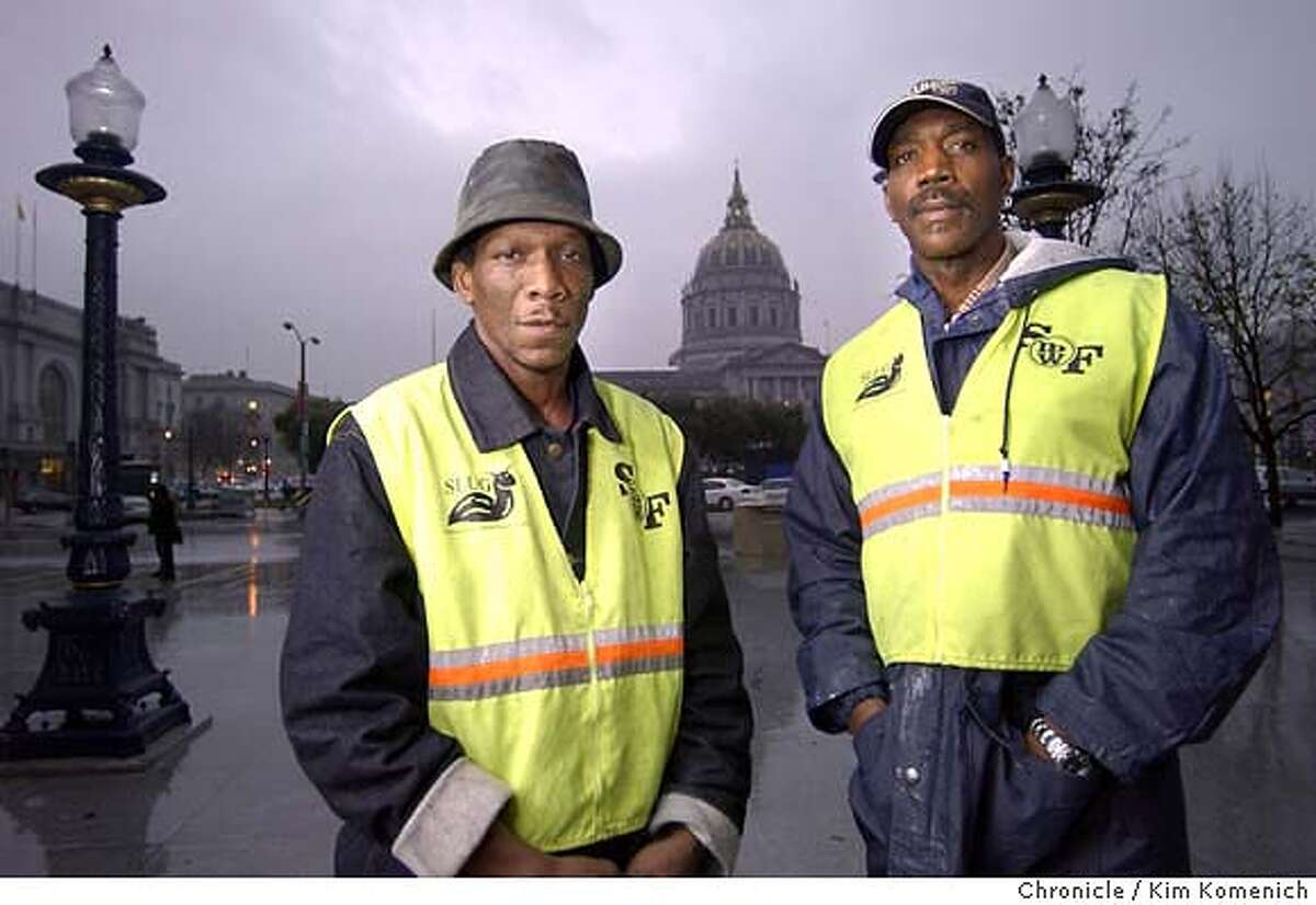 Ricky Anderson (L) and Oscar Hollin (R) are DPW workers who claim they were forced to work on the Newsom campaign. They are photographed in front of San Francsico City Hall on a very rainy day. KIM KOMENICH/The Chronicle