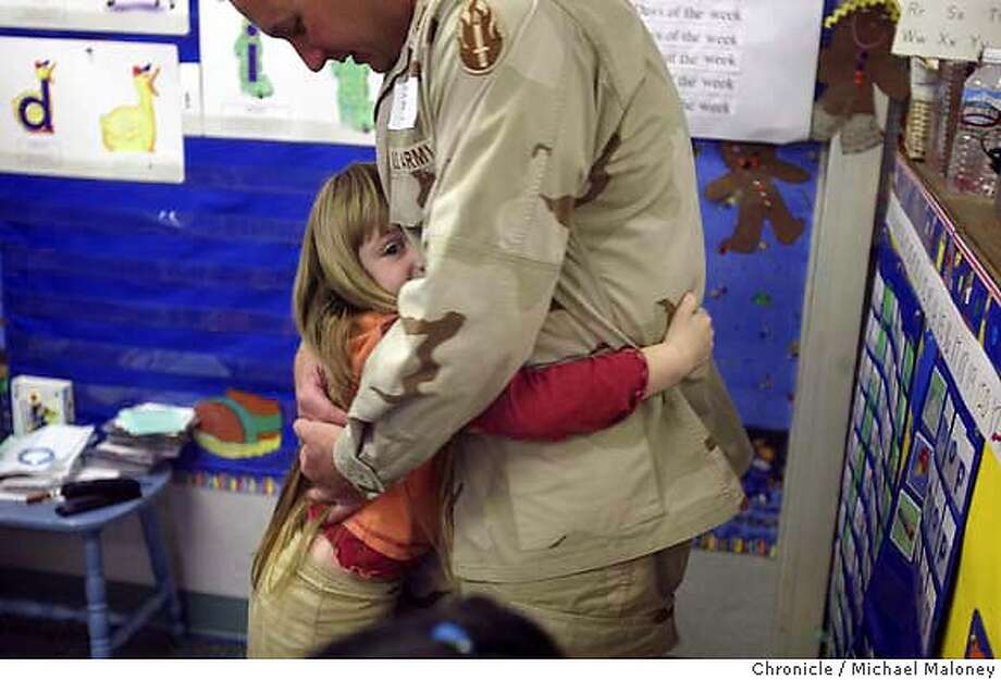"""Five year old Lane Fishburn gives her dad a big hug as he visits her kindergarten classroom.  Captain Jonas """"Jay"""" Fishburn of Manteca is home for a two week R&R from Iraq. He is in charge of the 341st Military Police Unit out of San Jose and is stationed just north of Baghdad. Fishburn has received many letters of support from the students of Manteca's Nile Garden Elementary School where his wife Lori Fishburn teaches and their two kids attend class. On this day, Fishburn visited the school to thank the kids.  Michael Maloney / The Chronicle Photo: Michael Maloney"""