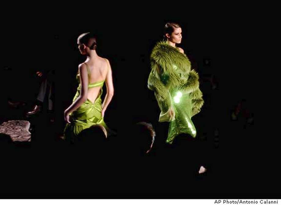 Two models are shown on the catwalk for Gucci for the last collection signed by Tom Ford, at the Fall-Winter 2004-2005 fashions in Milan, Italy, Wednesday, Feb. 25, 2004. (AP Photo/Antonio Calanni) Photo: ANTONIO CALANNI