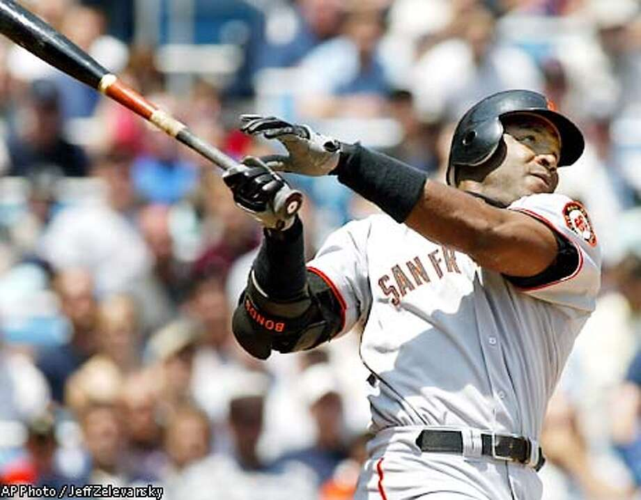 San Francisco Giants' Barry Bonds hits his 21st homer of the season, a 3-run shot in the first inning against the New York Yankees, Saturday, June 8, 2002 at New York's Yankee Stadium. (AP Photo/Jeff Zelevansky) Photo: JEFF ZELEVANSKY