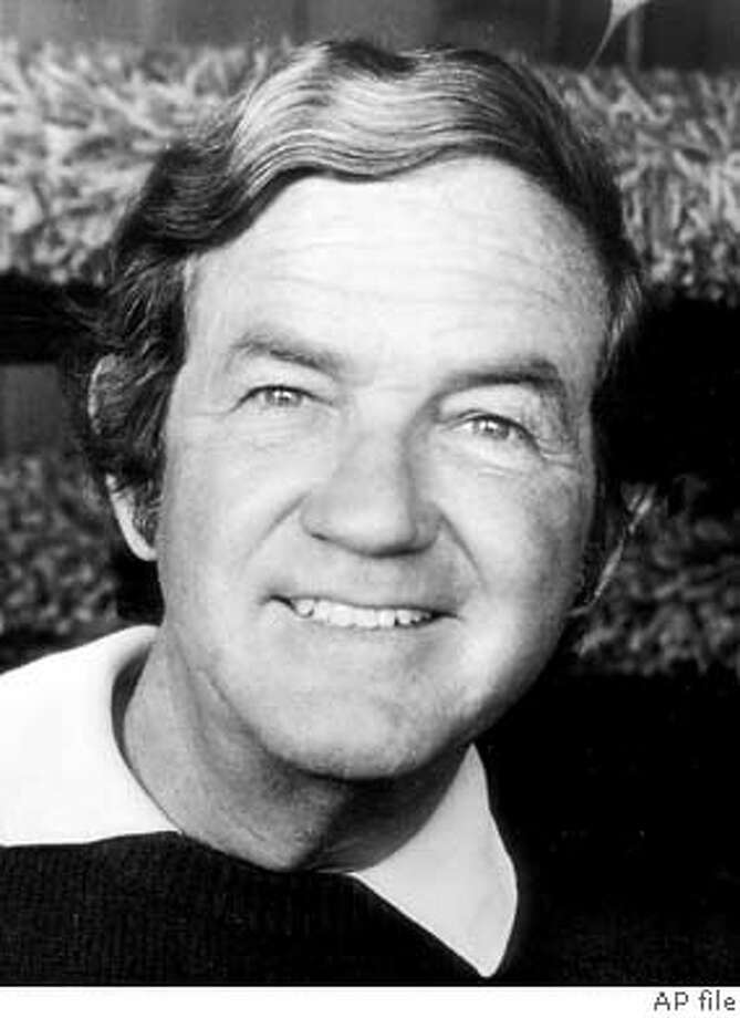 "** FILE ** Jerome Lawrence, shown in this 1974 file photo, who co-wrote hundreds of plays for stage, radio and screen, including ""Inherit the Wind"" and the musical ""Mame,"" died Sunday, Feb. 29, 2004, at his home in Malibu, Calif., from complications related to a stroke he suffered two years ago. He was 88. (AP Photo/Deborah Robinson, Rusty Morris) Jerome Lawrence is best known as the co-author of &quo;Inherit the Wind'' and &quo;Mame.&quo; Photo: RUSTY LAWRENCE"